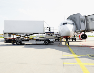 Catering Truck Servicing Passenger Aircraft